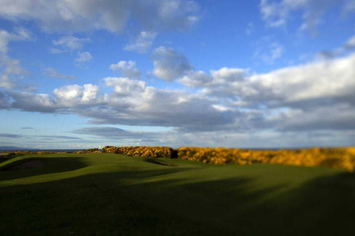 Image overlooking fairway gorse and the sky over the par-3 2nd hole at Royal Dornoch Golf Club, Scotland