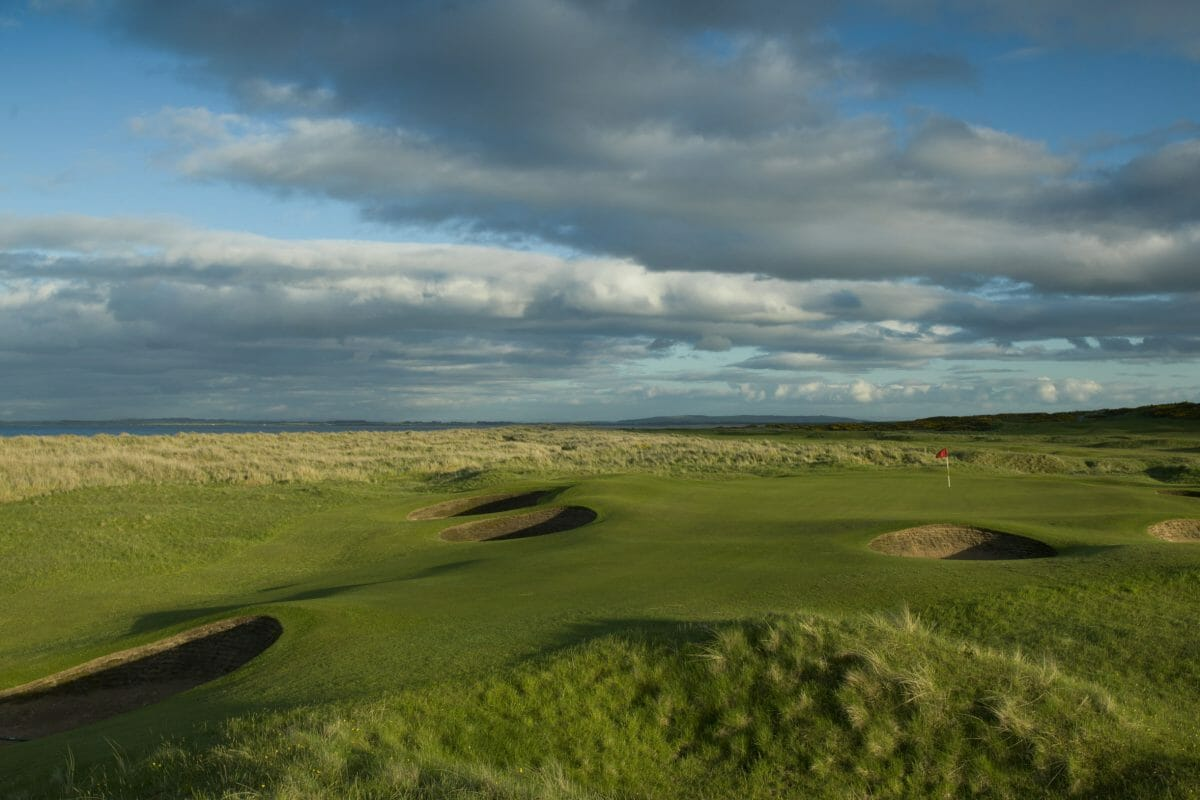 Image depicting the par-3 13th hole with many pot bunkers at Royal Dornoch Golf Club, Scotland