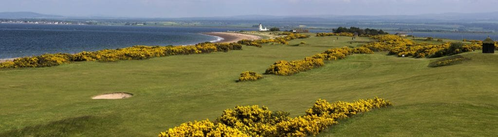 Image of the beach in the background and golf course in the foreground at Fortrose and Rosemarkie golf Links, Inverness, Scotland