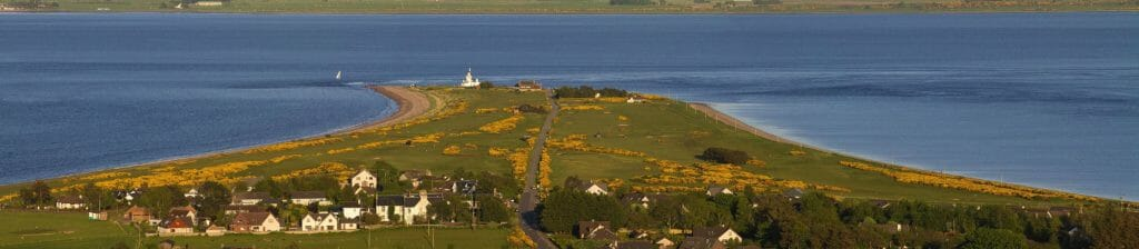 Image of the golf complex surrounded by the Moray Firth, Fortrose and Rosemarkie golf Links, Inverness, Scotland