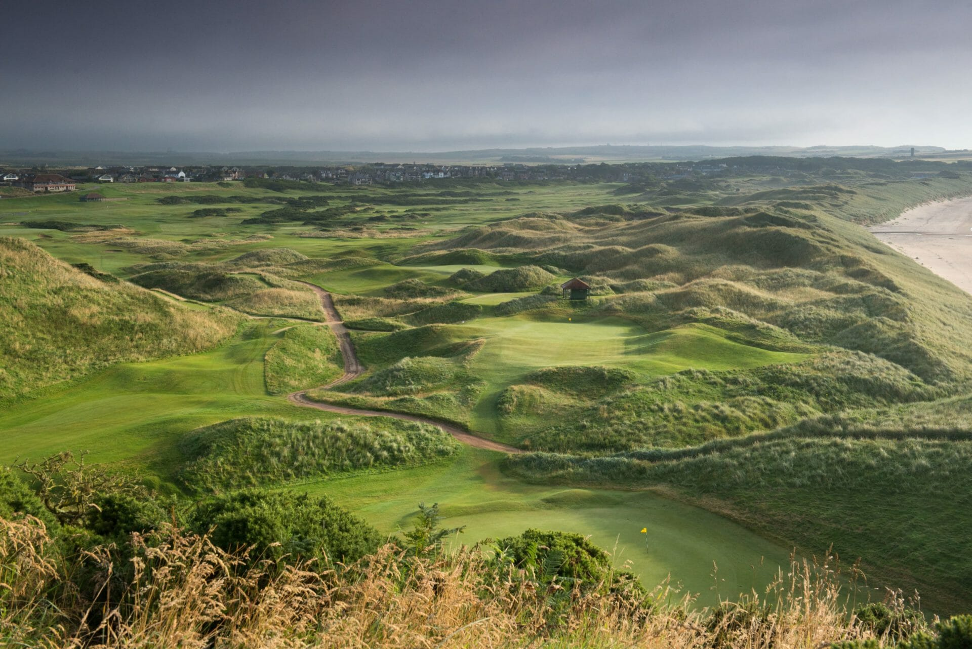 Image taken from a tee box looking down on the links golf course at Cruden Bay Golf course, Aberdeenshire, Scotland