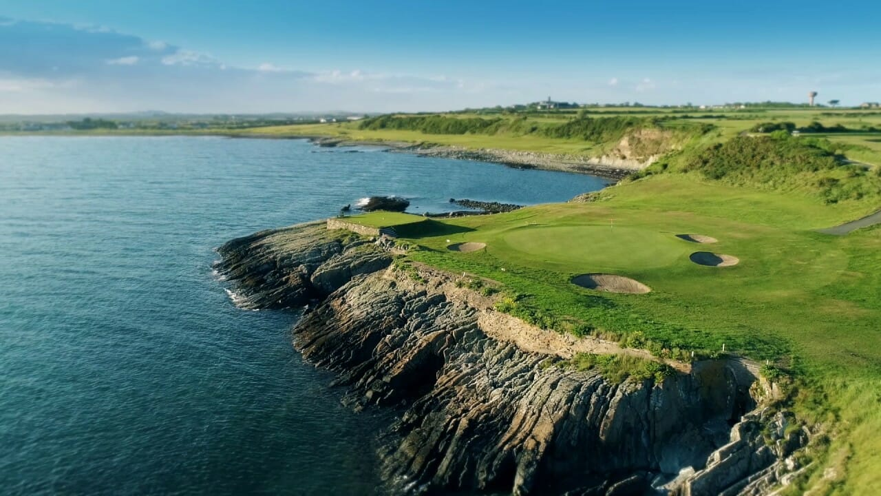 Aerial image of rock contrasting with the green of the golf course at Ardglass Golf Club, Northern Ireland