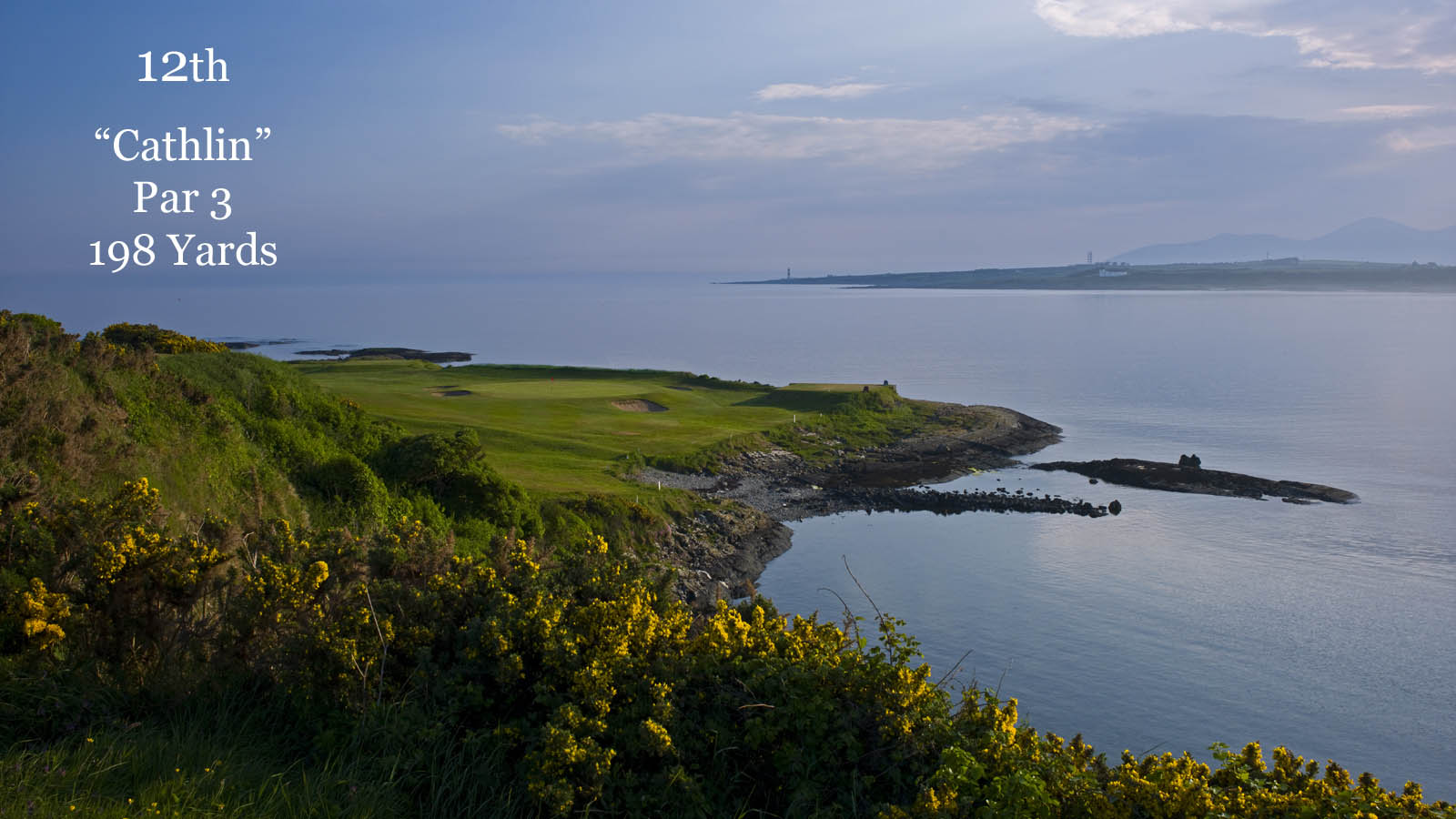 Image overlooking the sea and 13th green on the golf course at Ardglass Golf Club, Northern Ireland