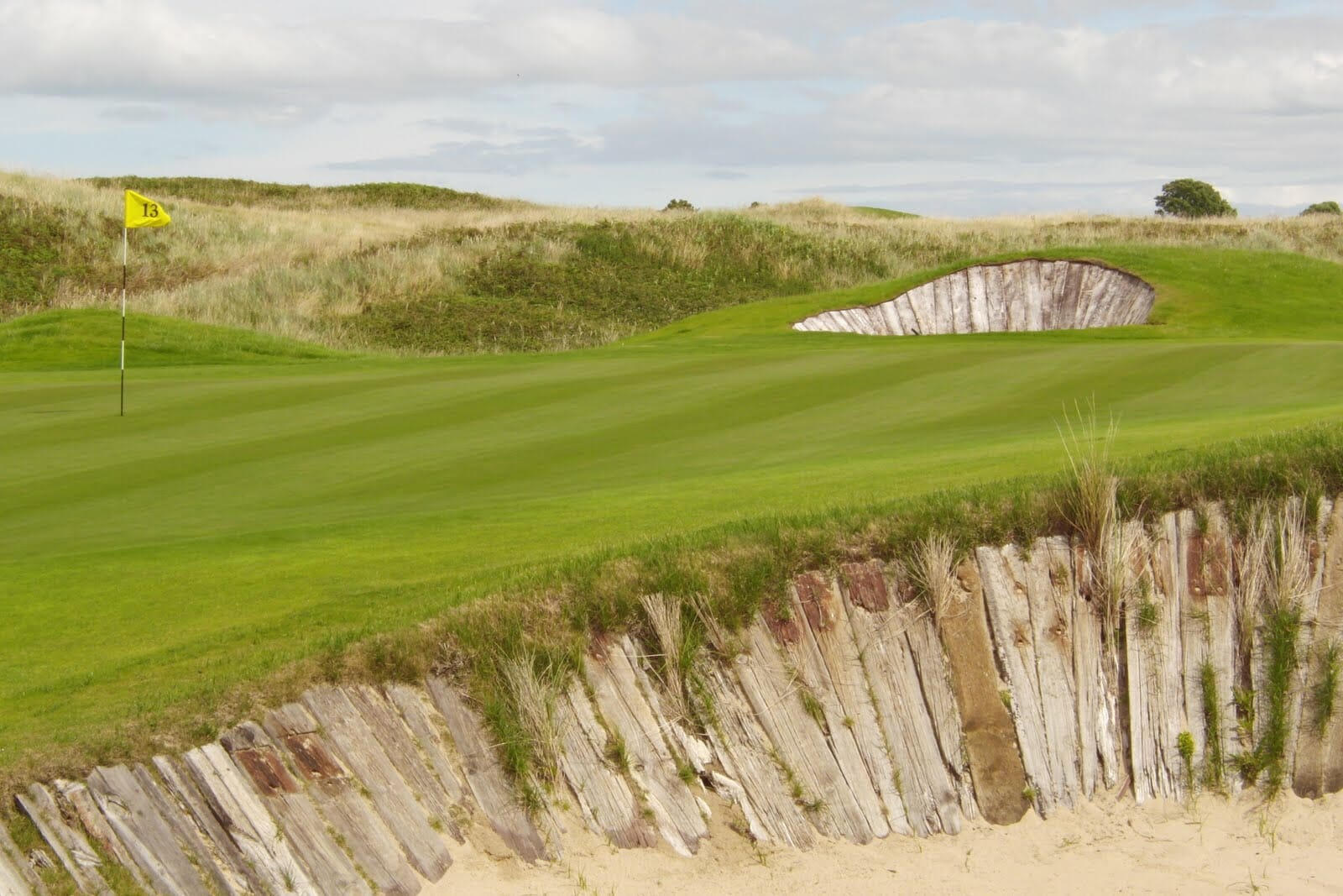 Image depicting the 13th green with the classic Railway Sleeper Bunkers at The European Golf Club, Ireland