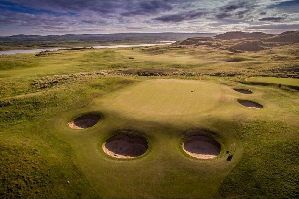 Aerial image of a green surrounded by pot bunkers at Portsteward Golf Club, Northern Ireland