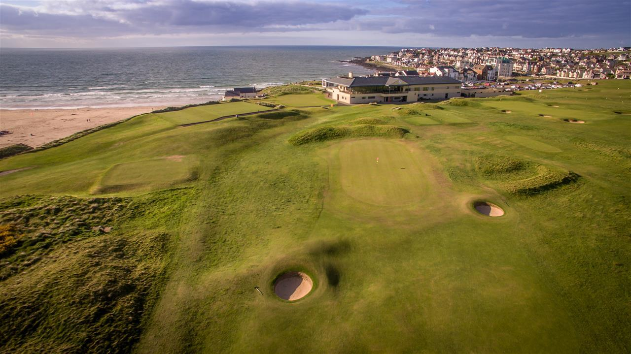 Aerial image of the Portstewart Golf Club and nearby town