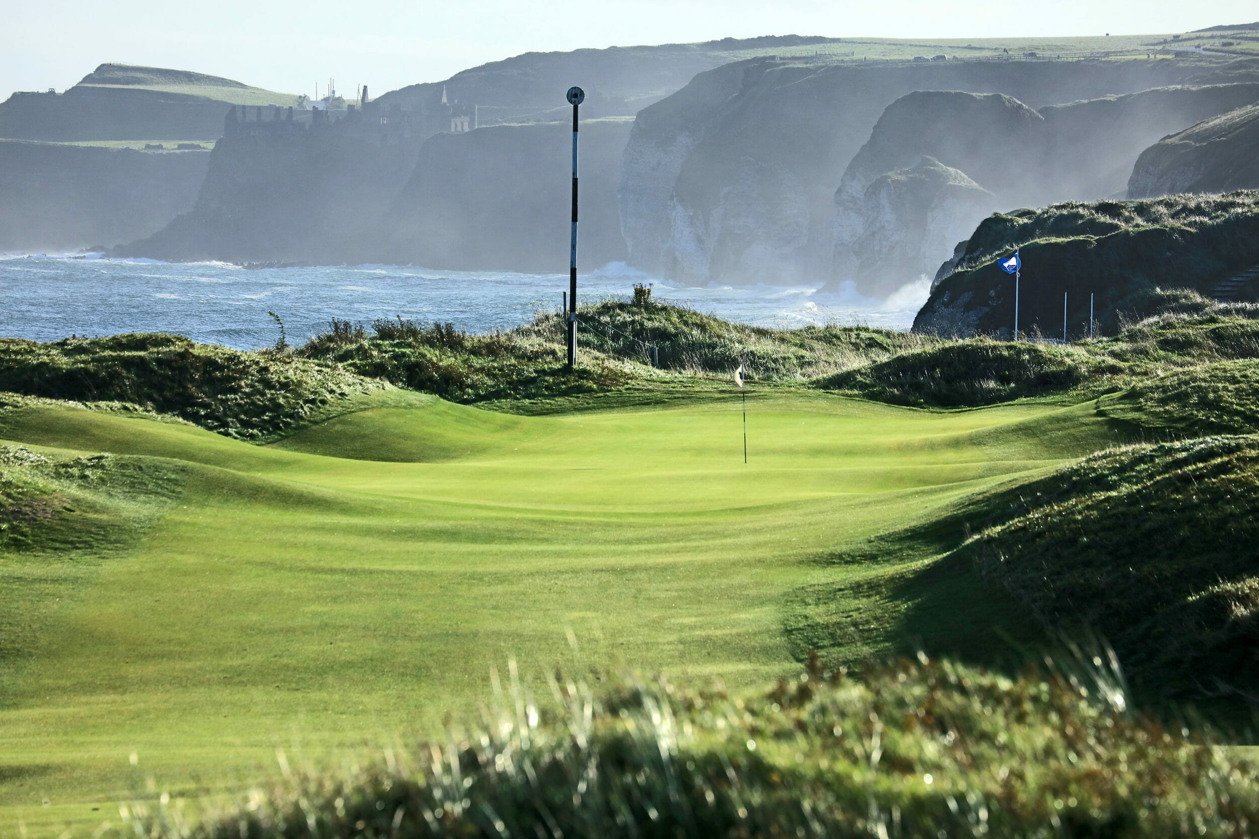 Image of a narrow fairway leading to Dunluce Castle, Royal Portrush Dunluce Golf Course, Portrush, County Antrim, Northern Ireland