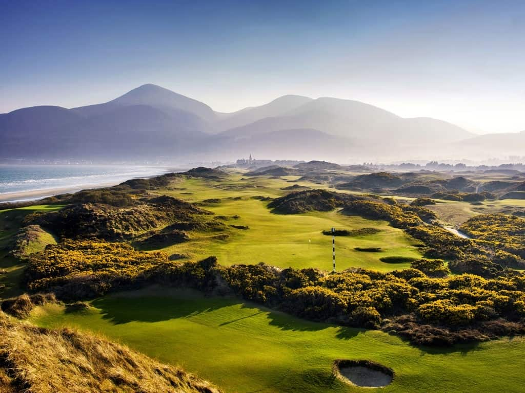 Image overlooking the 2nd hole in the morning mist at Royal County Down Golf Club, Northern Ireland