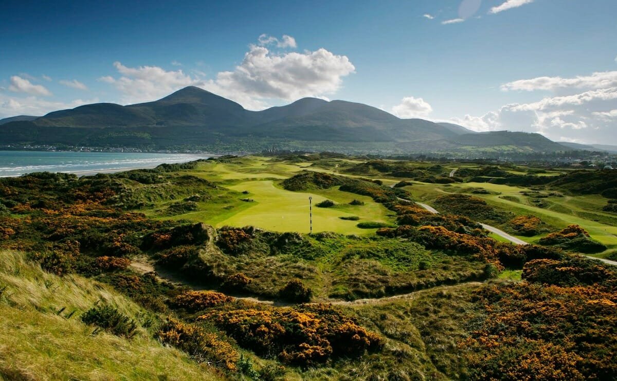 Image overlooking the 2nd hole and distant mountains at Royal County Down Golf Club, Northern Ireland