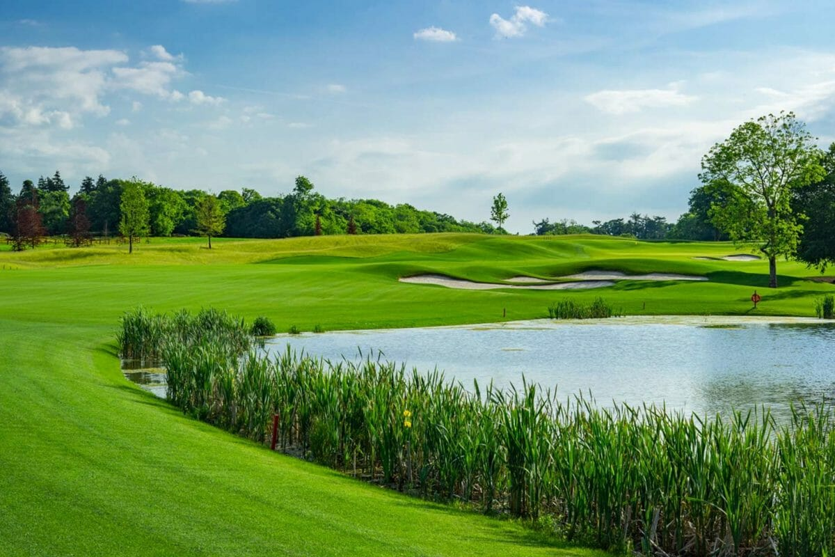 Image depicting the 5th hole and large lake on the golf course at Adare Manor, County Limerick, Ireland, Europe