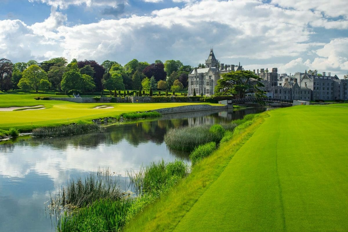 Image depicting the river running next to the 18th green and resort building at Adare Manor, County Limerick, Ireland, Europe