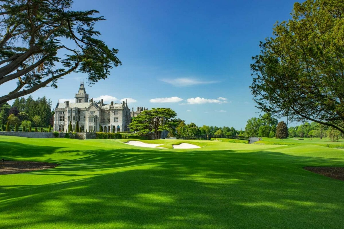 Image depicting the 18th hole and old manor building at Adare Manor, County Limerick, Ireland, Europe
