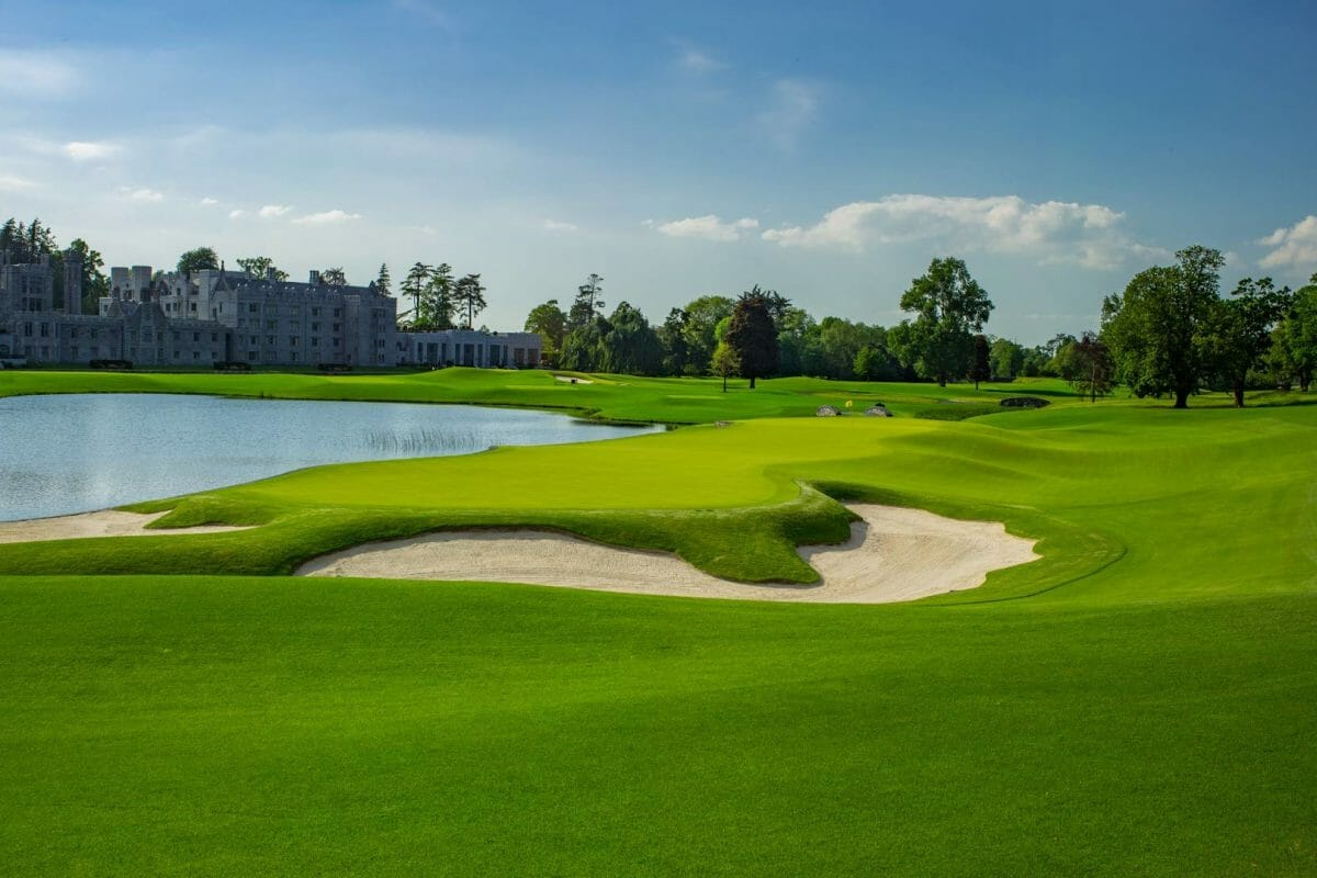 Image of the 16th hole green looking back towards the main resort building at Adare Manor, County Limerick, Ireland, Europe
