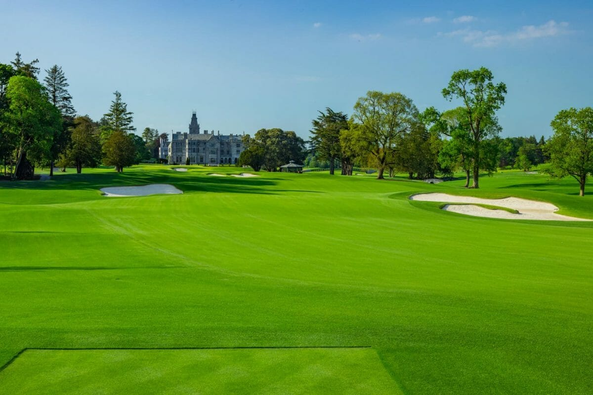 Image depicting the 9th hole and distant manor building at Adare Manor, County Limerick, Ireland, Europe