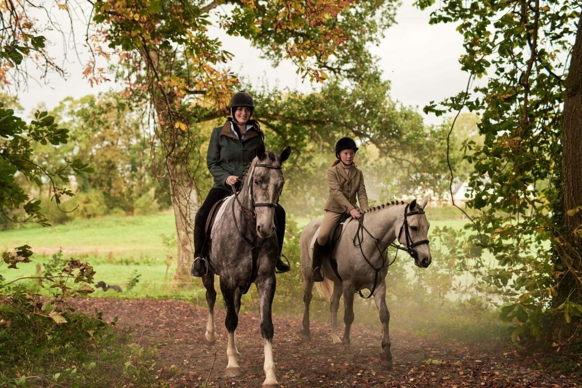 Image depicting two females riding horses on the expansive grounds at Adare Manor, County Limerick, Ireland, Europe