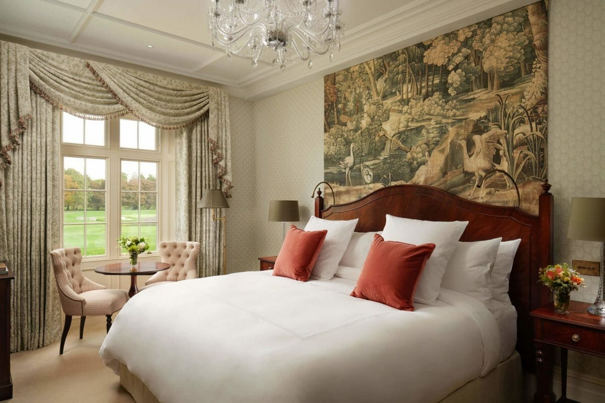 Image of a classic room bed and window at Adare Manor, County Limerick, Ireland, Europe