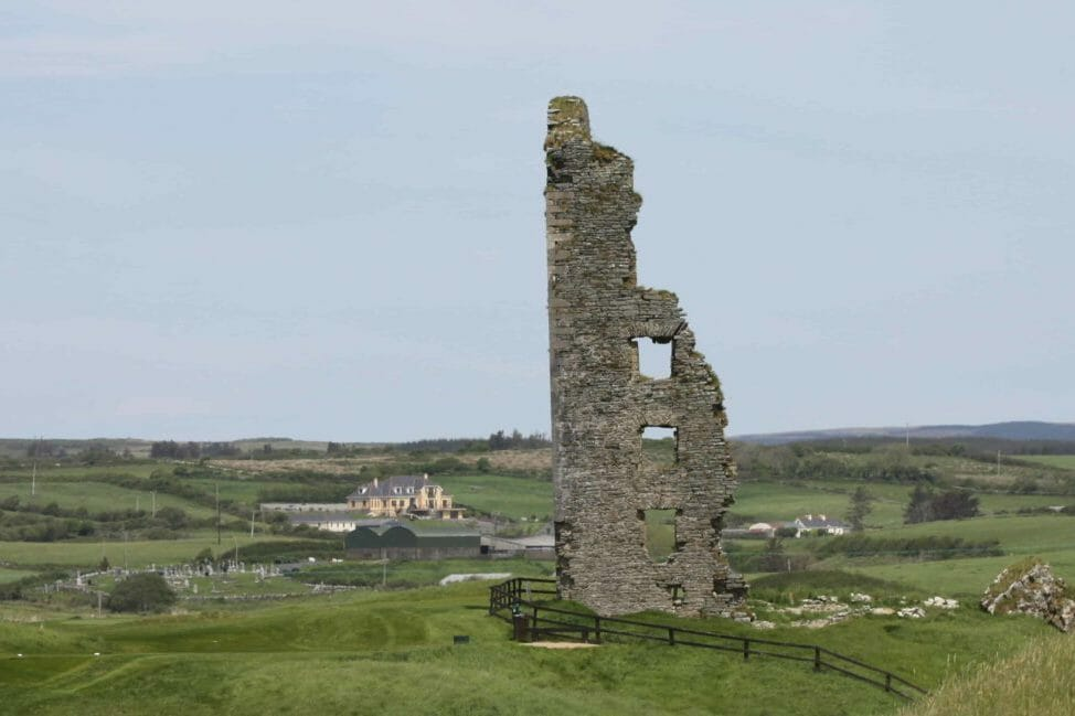 Image displaying the tall ruins of an old castle at Castle Golf Course at Lahinch Golf Club, County Clare, Ireland