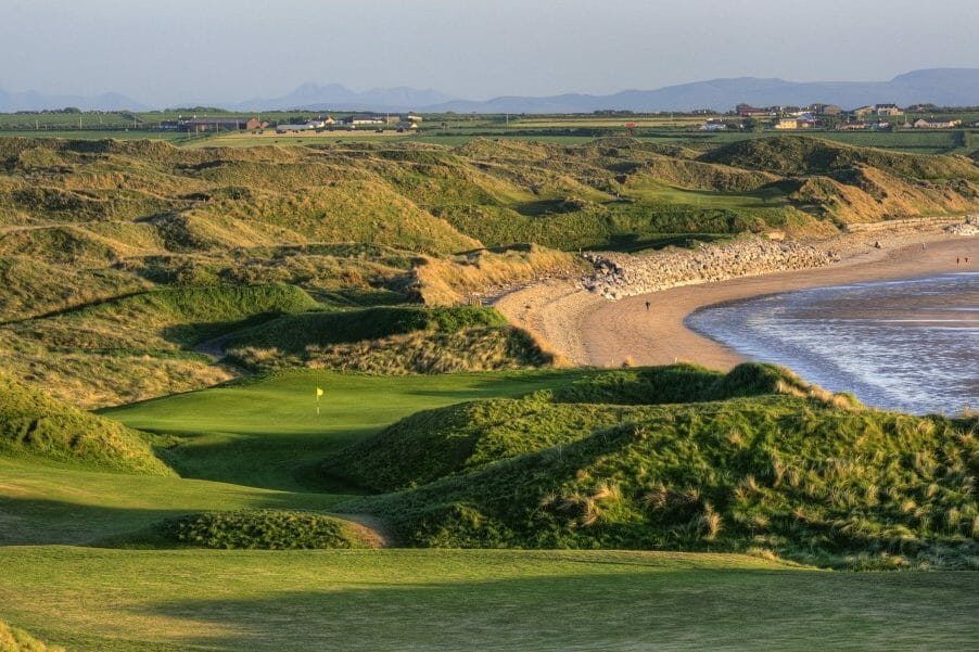 Image depicting the 11th Tee looking down at the green and adjacent beach on the old Golf Course at Ballybunion, County Kerry, Ireland
