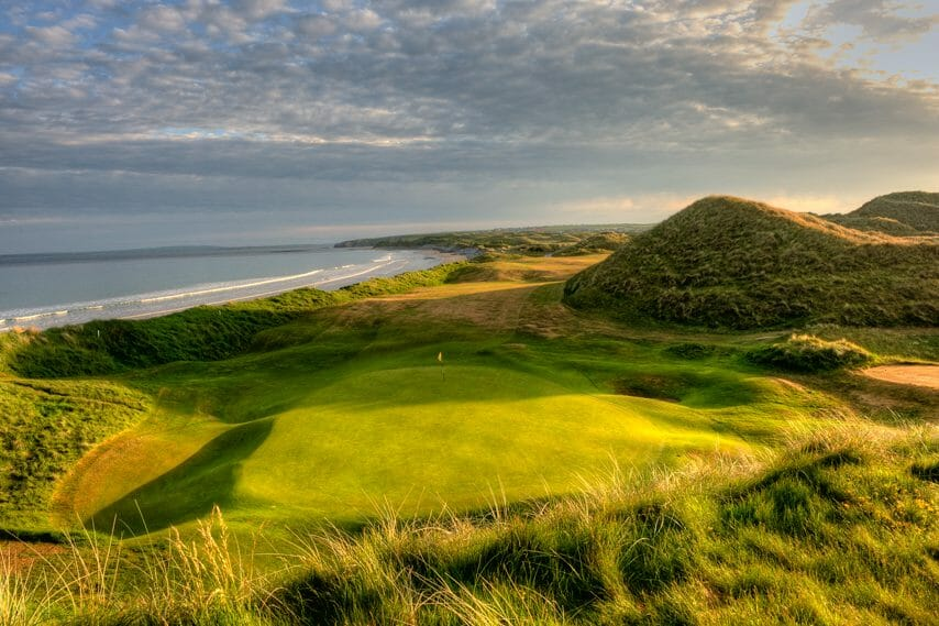 Image overlooking the 17th green and distant beach on the Old Golf Course at Ballybunion, County Kerry, Ireland