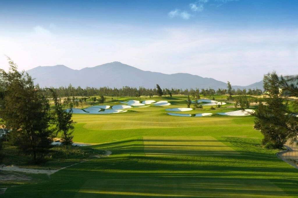 Image displaying the links-style bunkers from a tee box at Montgomerie Links Vietnam Golf Course, Da Nang, Vietnam, Asia