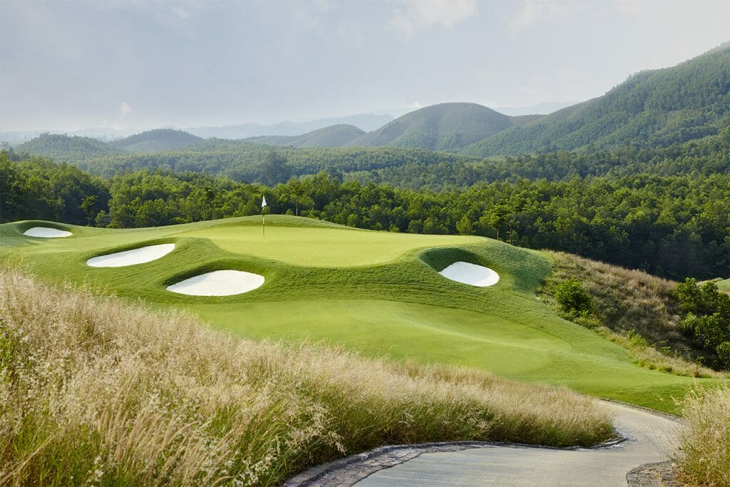Image of the 12th green and distant mountains at Ba Na Hills Golf Club, Da Nang, Vietnam