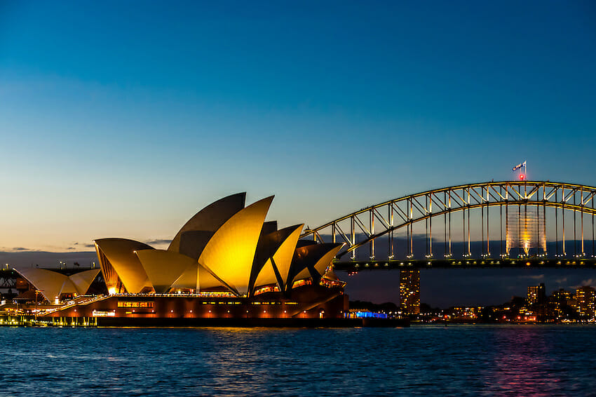 Twilight view of the Sydney Harbour Bridge in the background and the Opera House in the foreground, Australia