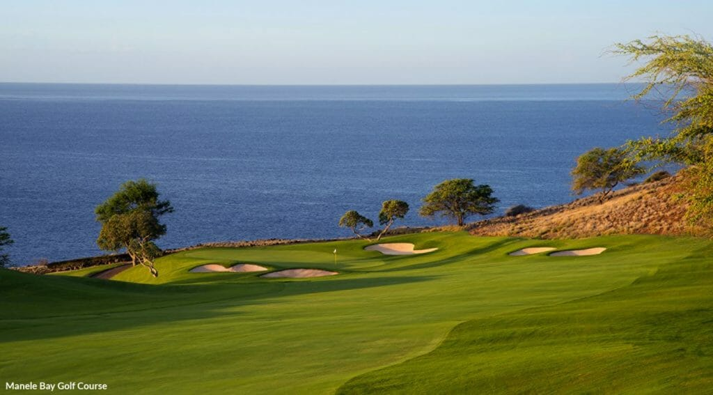 Image contrasting the Green Manele Bay Golf Course with the blue of the ocean, Lanai, Hawaii, USA