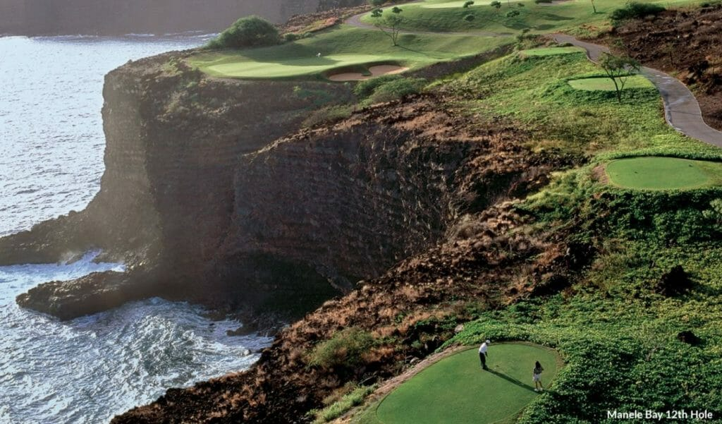 Aerial image of golfers teeing off on the Manele Bay 12th hole, Lanai, Hawaii, USA