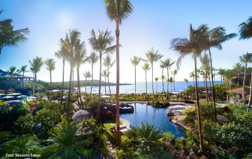 Image displaying the pool and distant beach at the Lanai Four Seasons Resort, Hawaii, USA
