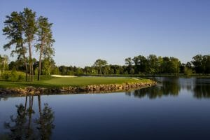 The twelfth green is surrounded on three sides by a large lake at Sentryworld Golf Course