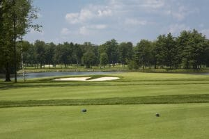 Overlooking the par-three third hole at Sentryworld Golf Course and distant lake
