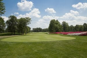 Large tee box leads to an open first fairway at Sentryworld Golf Course