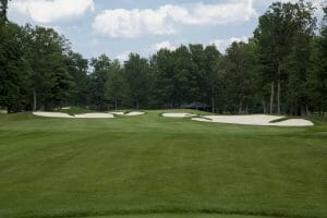 The eighth green is guarded by many bunkers at Sentryworld Golf Course