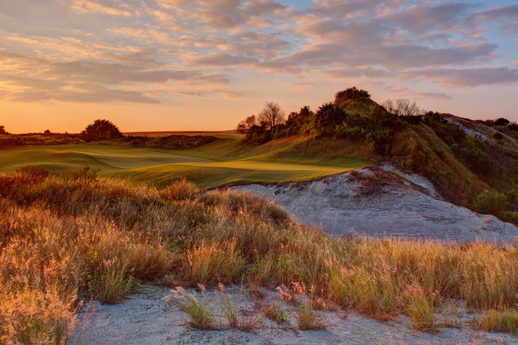 Dusk touches the golf course turning it red at Streamsong Golf Resort in Florida