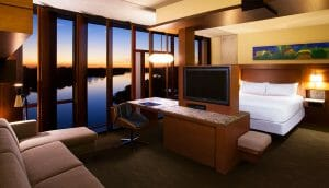 Twilight view of lights shining in a bedroom at Streamsong golf Resort in Florida, USA