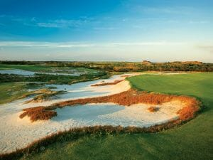 Golden dusk sunlight touches the Black Golf Course at Streamsong Resort in Florida