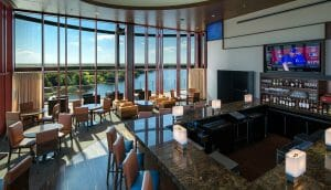 Interior view of the bar and restaurant overlooking a lake at the Golf Resort in Streamsong, Florida