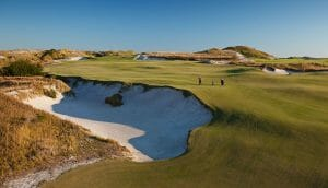 Two golfers play on the open fairways of the fifteenth hole at Streamsong Resort in Florida