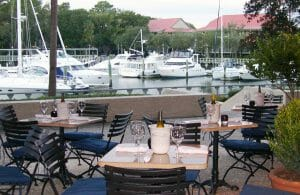 Dining on a terrace overlooking boats in a marina at Palmetto Dunes Oceanfront Resort Hilton Head