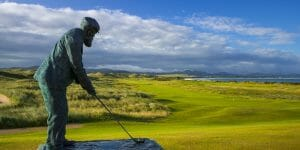 A statue of Golf architect and legend Old Tom Morris stands in front of the golf courses at Rosapenna Golf Resort, Ireland
