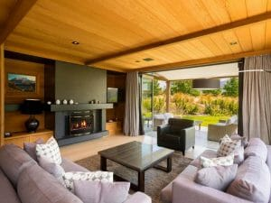 Looking into the lounge room of a rental property at Millbrook Resort New Zealand