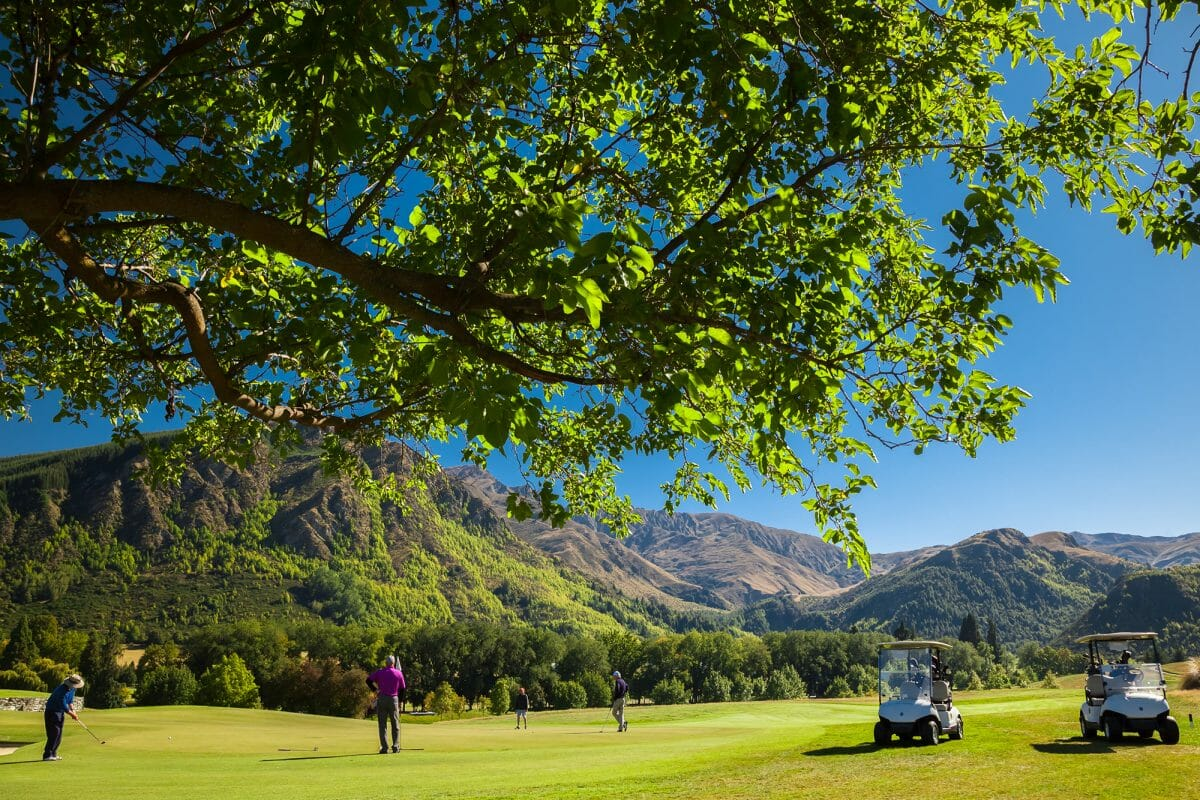 Image viewing golfers on a green at Millbrook Resort New Zealand