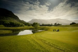 Image displaying golfers playing the Millbrook Coronet Nine Course in New Zealand