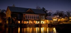 A twilight view of the Millhouse Restaurant on the waterfront in New Zealand's Millbrook Resort