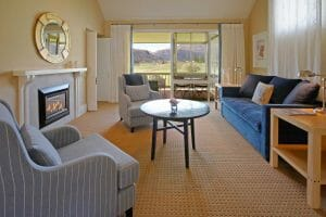 Image displaying the inside of a lounge room and view of the Millbrook Resort Golf Course, New Zealand