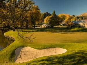 Image overlooking a green-side bunker on the golf course at Millrbrook Resort, New Zealand