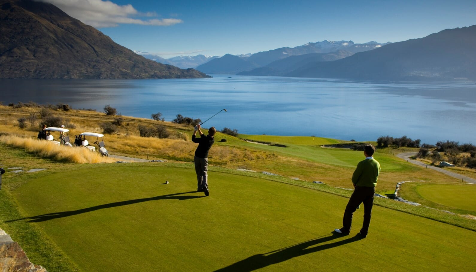 Image displaying travelling golfers teeing off at Jack's Point Golf Course, Queenstown