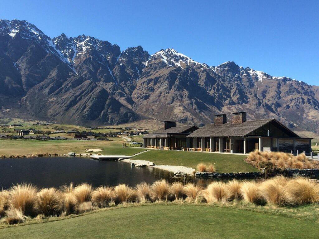Daylight image of Jack's Point Clubhouse and Remarkables Mountain Range in New Zealand