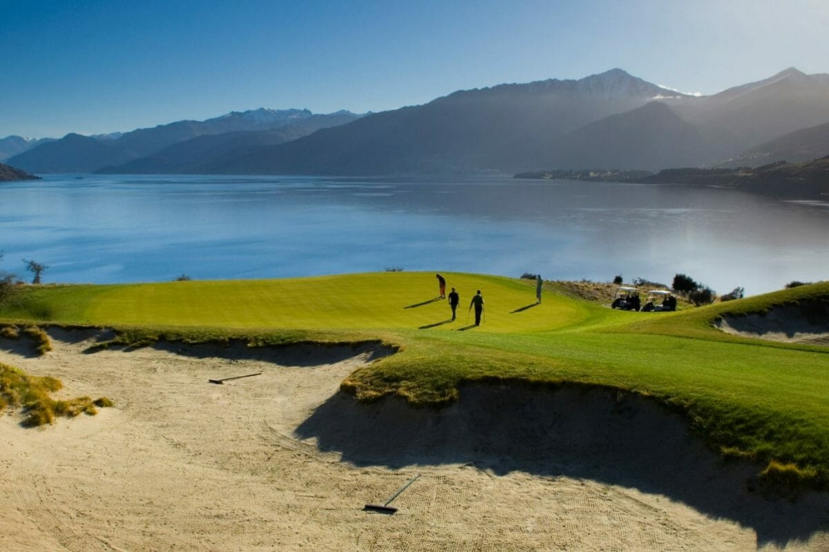 Image of golfers on a putting green at Jack's Point Golf Course in New Zealand's South Island