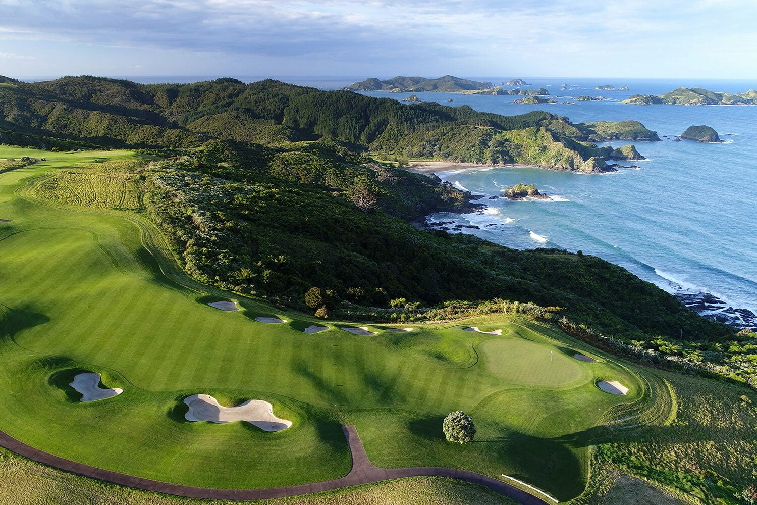 Aerial image displaying the Kauri Cliffs Golf Course and distant Bay of Islands in New Zealand